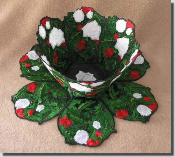 BFC385 Holly & White Roses Bowl + Doily in  FSL.  Bright vivid colors are what calls to many of us during the Holiday Season, and with winter being so dreary maybe its what we need.  Please feel free to change the colors of the roses to what pleases you. Fill the bowl with pine cones or scented potpourri.  If you put edible items in it, placing a plastic liner or bag between the food & the bowl is suggested.  Full instructions included w/ your purchase. 4x4 & larger hoops, sample on the…
