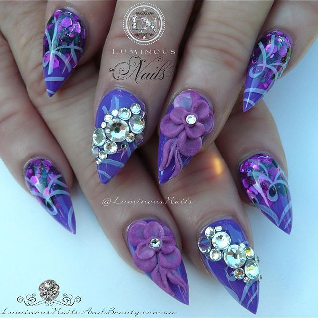 Pretty Purple Nails with 3D Flowers & Swarovski Crystals  Inspired by @sarahp898  Sculptured Acrylic with Indigo Violet Candy, @glitter_heaven_australia Poison Ivy Glitter Mix, Konad Stamping, Swarovski Crystals #glitterheaven #indigo #swarovskicrystals #3Dflowers #stamping #acrylicnails #pretty #purple #sculptured #shiny #glossy #luminous #byteena #luminousnails #luminousnailsandbeauty #goldcoast #queensland #australia #sparkle #frosting