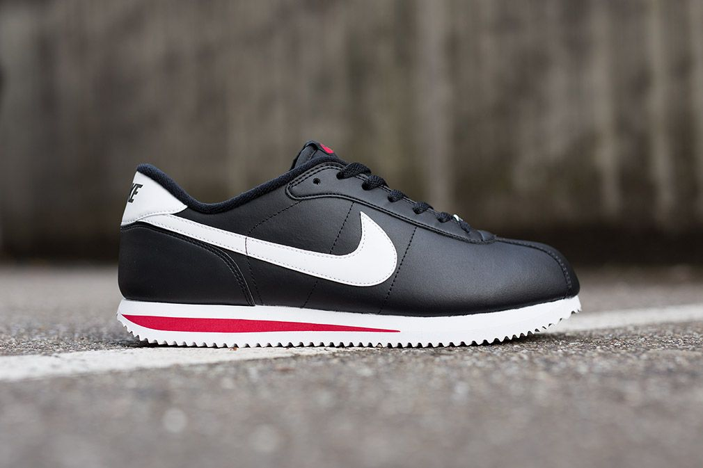 Nike's ultimate classic, the Cortez is donning leather on leather digs this  season. Included in the series is this black and white colorway that is cut  wit