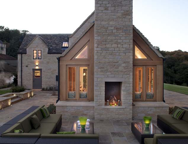 Cosy exterior for house in Cotswold. Love the outdoor fire/ seating ...