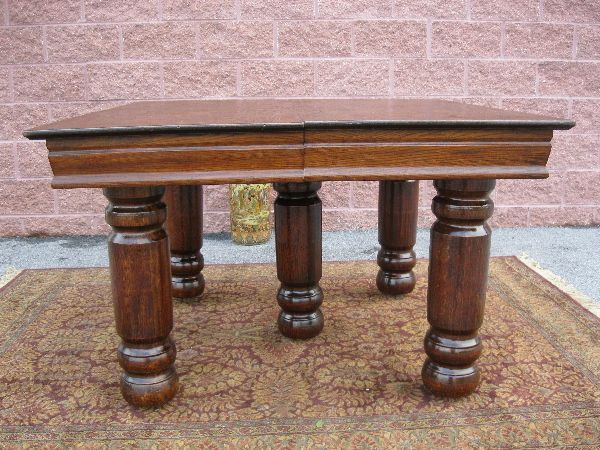 Pictures of antique oak tables with stored leaves for Solid oak dining table with leaf