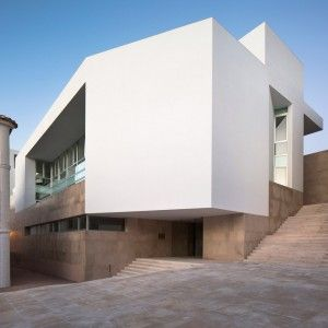 Daroca+Arquitectos+pairs+white+walls+with+natural+stone+for+Baza+employment+centre