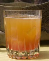 Pink Flamingo - Vodka, Cointreau, orange juice, dash of sloe gin.