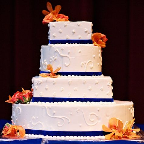 square wedding cakes with ribbon and flowers square wedding cake with blue ribbon and orange flowers 20429