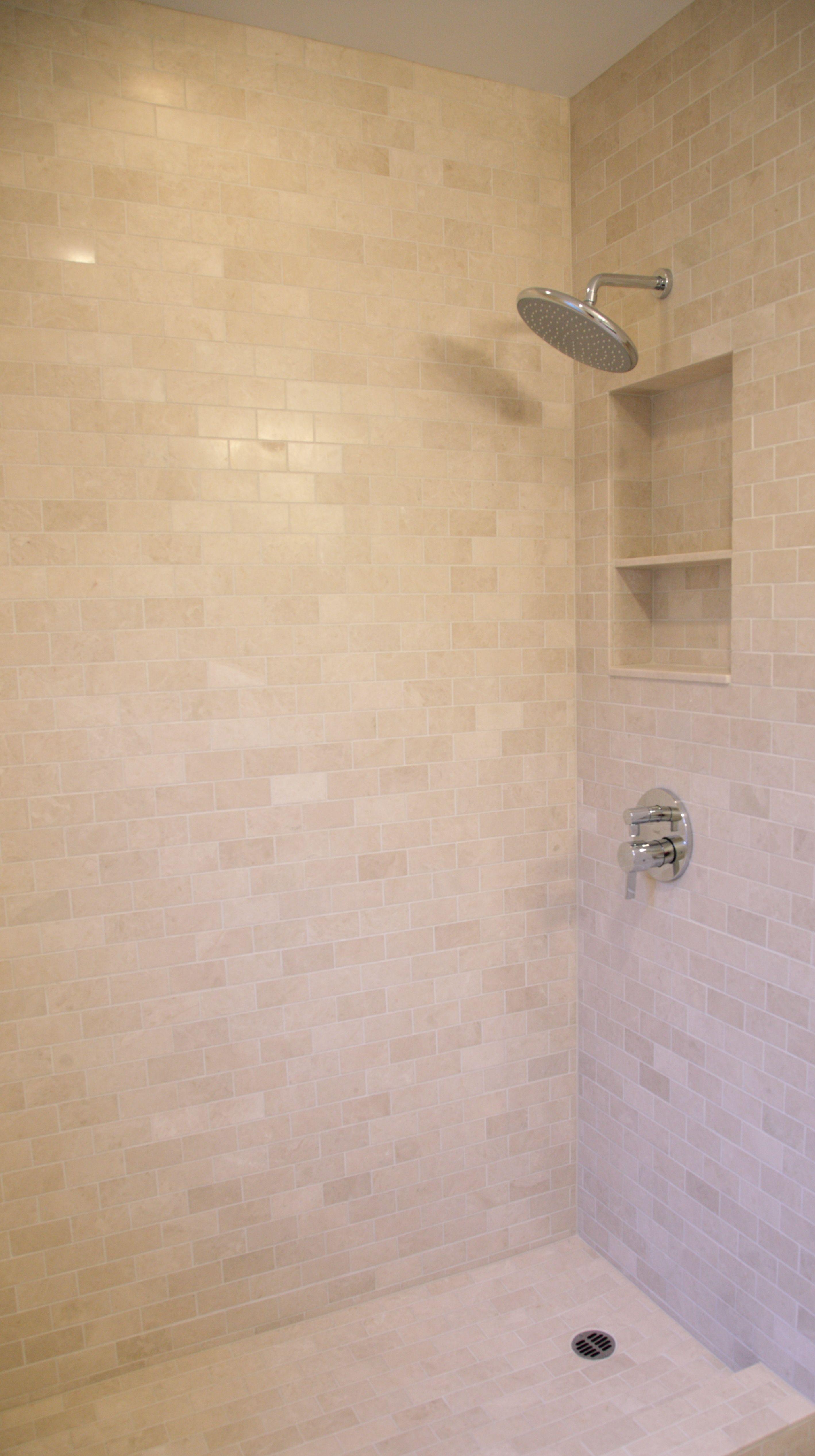Crema Ella Agora S Beloved Soft Cream Color Marble Here In A Shower Installation In 3 X 6 Subway Tile Form Cream Tile Bathroom Bathroom Colors Tile Bathroom
