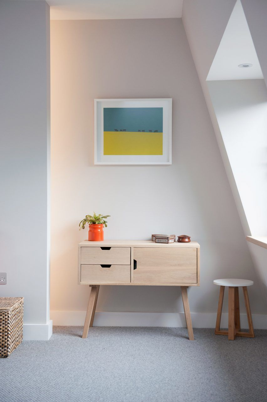 Colourful accents including orange lamps and brightly