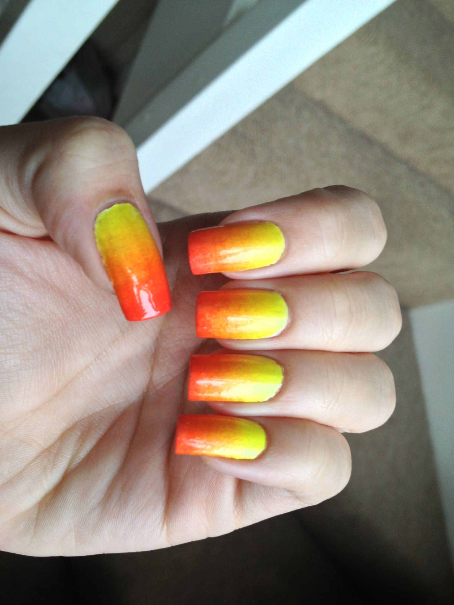 yellow orange coral gradient nails