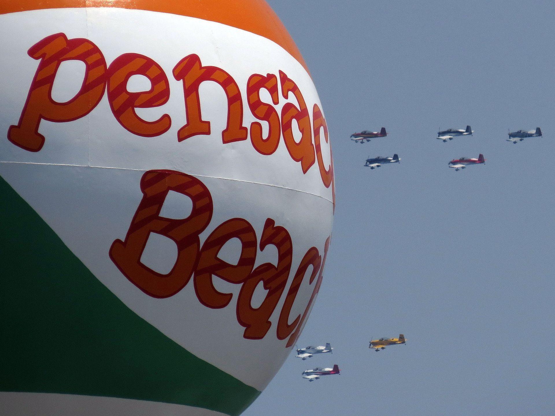 Civilian aircraft pass by the Pensacola Beach ball water