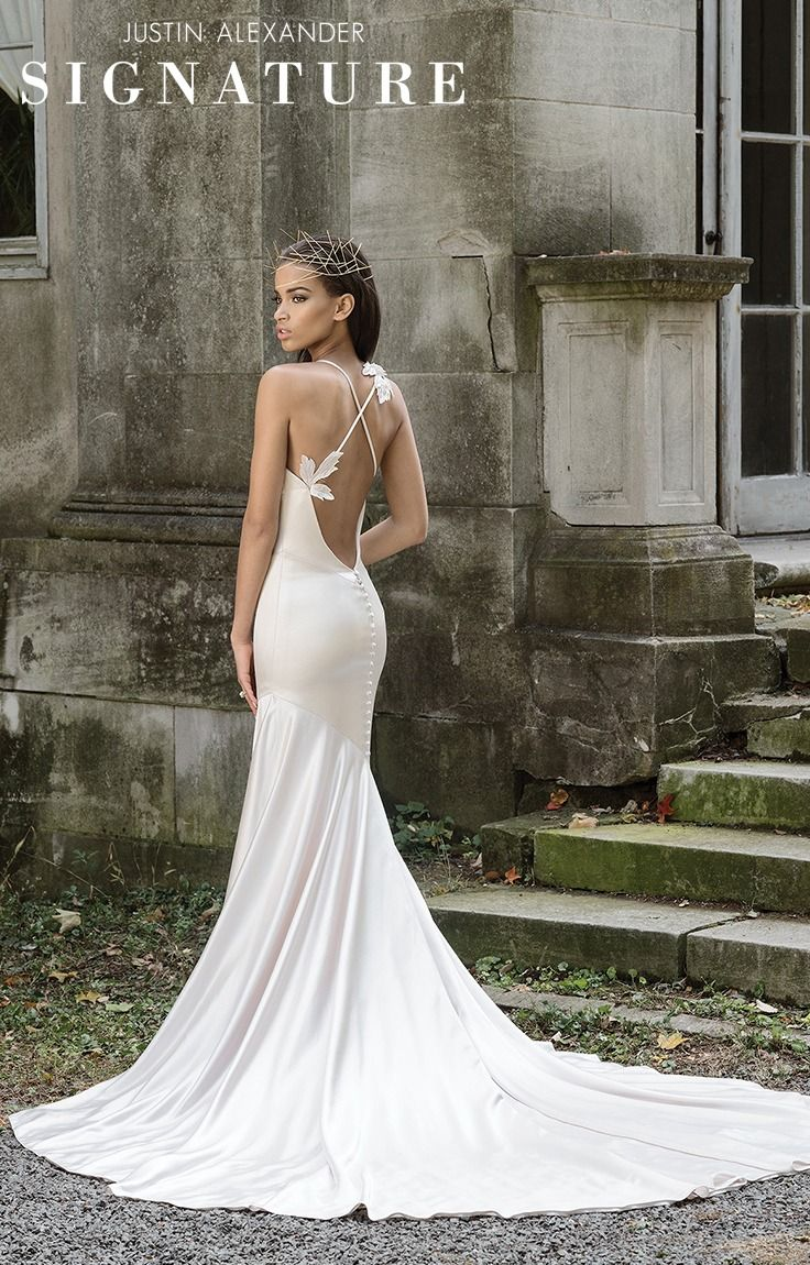 Low cut wedding dresses  This asymmetrical fit and flare is made from Luxe Charmeuse and