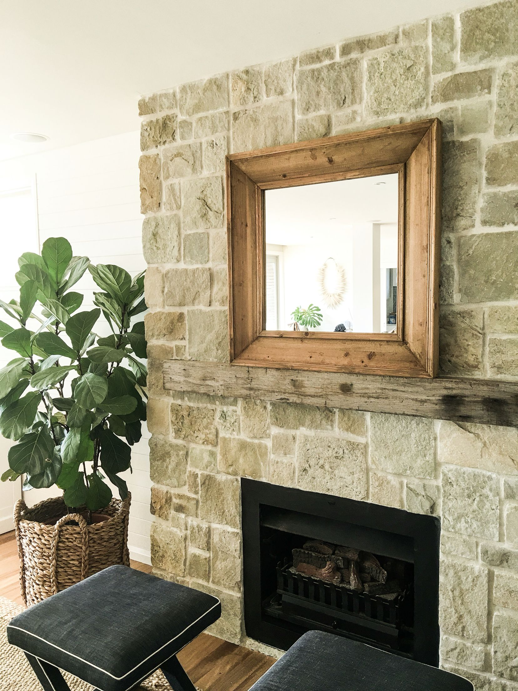 Fireplace with timber framed mirror above the mantel mirrors