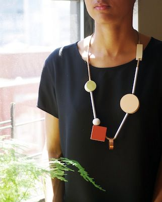 The necklaces by Ladies & Gentlemen Studio over at the supa-cool design hub Sight Unseen will make you have feelings for geometry you never knew you were capable of. If you're in the market for home goods, their (cylindrical) salt 'n pepper shakers are real winners, too. —erica