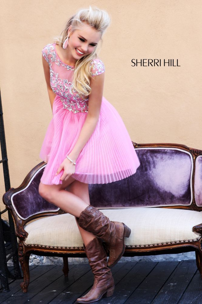 Pink dresses with cow boy boots can never go wrong \
