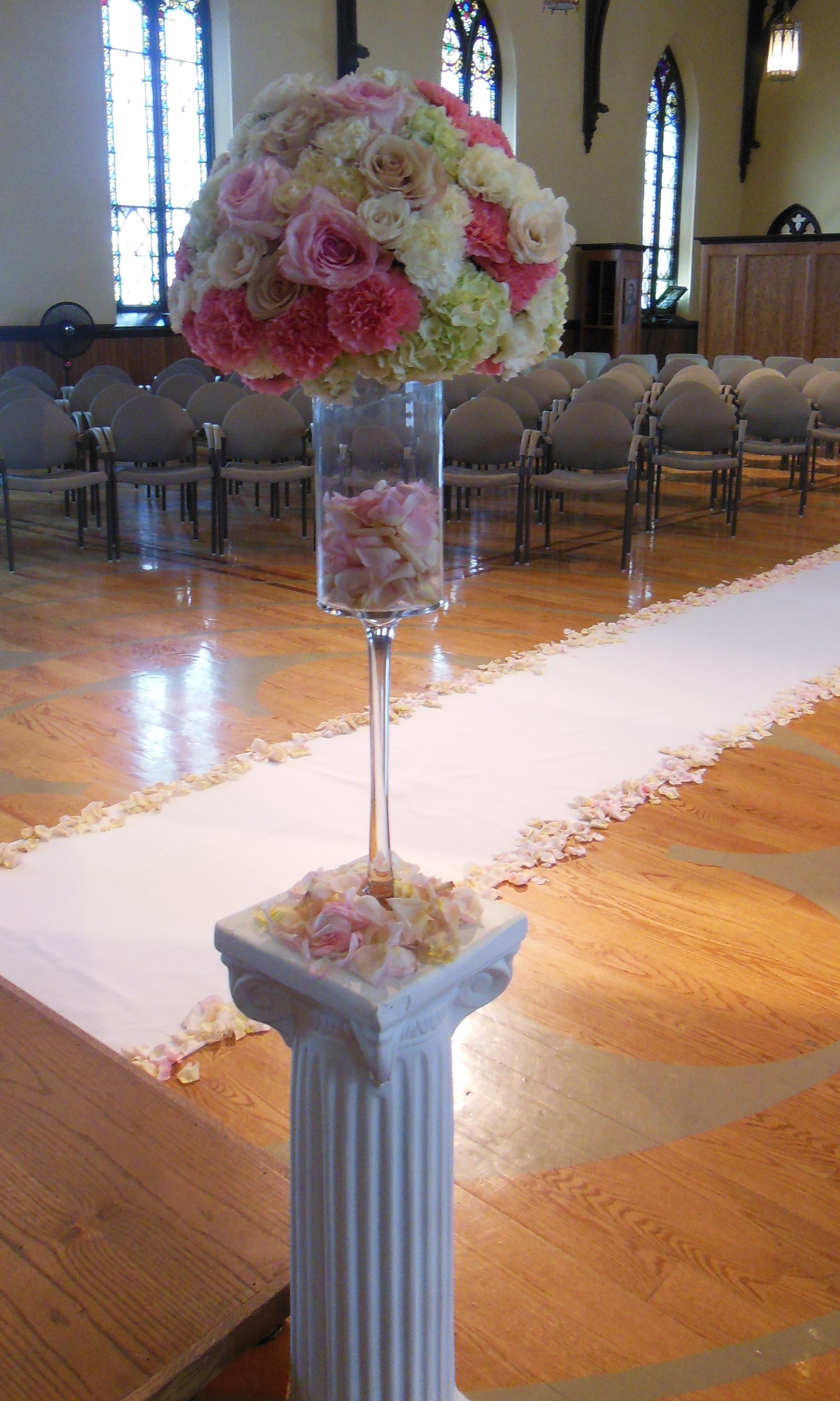 stemmed vase with a pave of vintage hydrangea roses and carnations