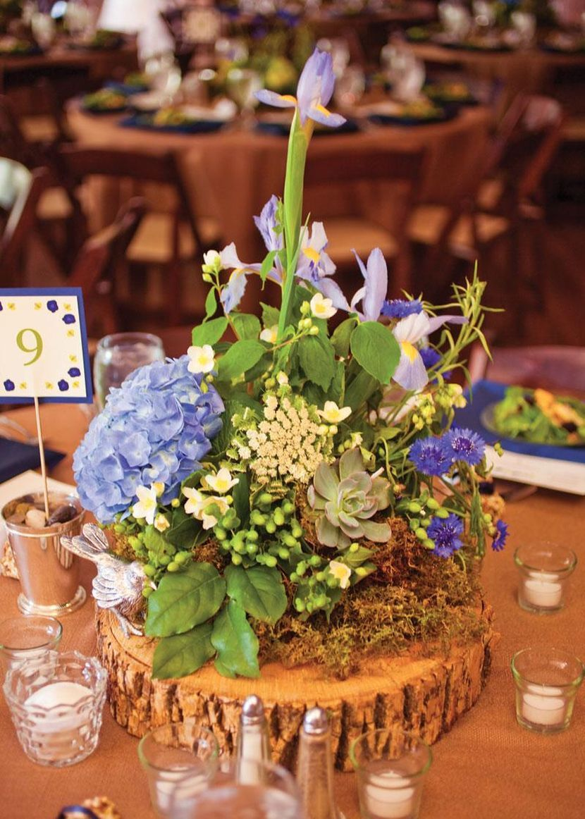 Stunning rustic wooden base wedding table setting with