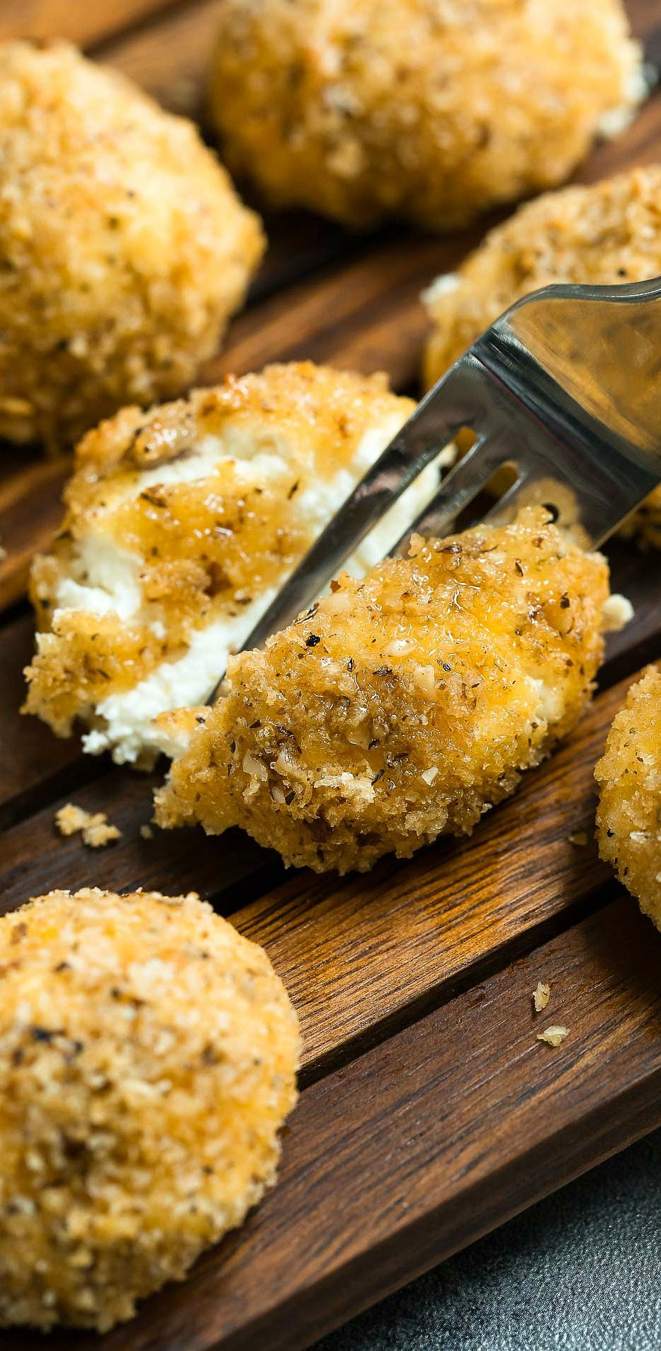 LOVING these walnut panko baked goat cheese balls! These honey drizzled crispy goat cheese bites are baked instead of fried and make a fabulous appetizer or salad topping and are the star of any cheese or charcuterie board!