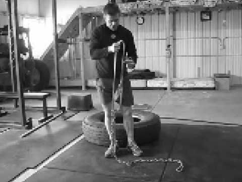 Rigging tire to drag by military athlete garage gym garage gym