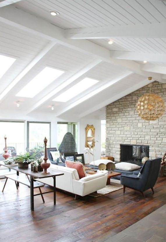 Amy Butlers Living Room With Gorgeous IKEA Maskros Pendant Spraypainted Gold Wide Plank Floors White Ceiling And Beams Skylights Light Brick