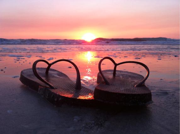 Flip-Flops taking in the Sunrise on Naples Beach FLORIDA