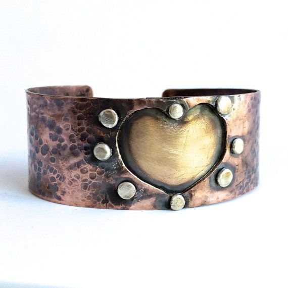 Hey, I found this really awesome Etsy listing at https://www.etsy.com/listing/211697618/handmade-copper-cuff-with-brass-heart