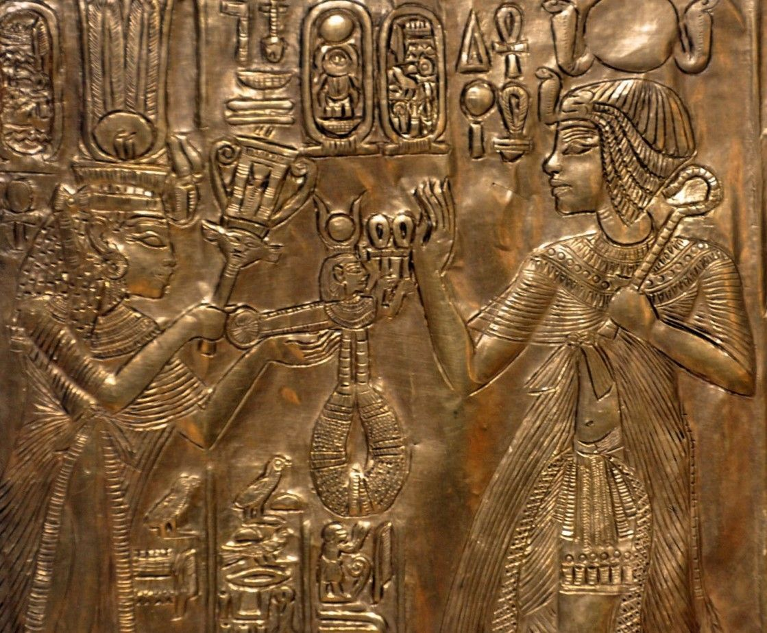 Detail of a scene from the Little Golden Shrine found in the Tomb of Tutankhamun, which is covered in scenes of him with his wife, Ankhesenamun.
