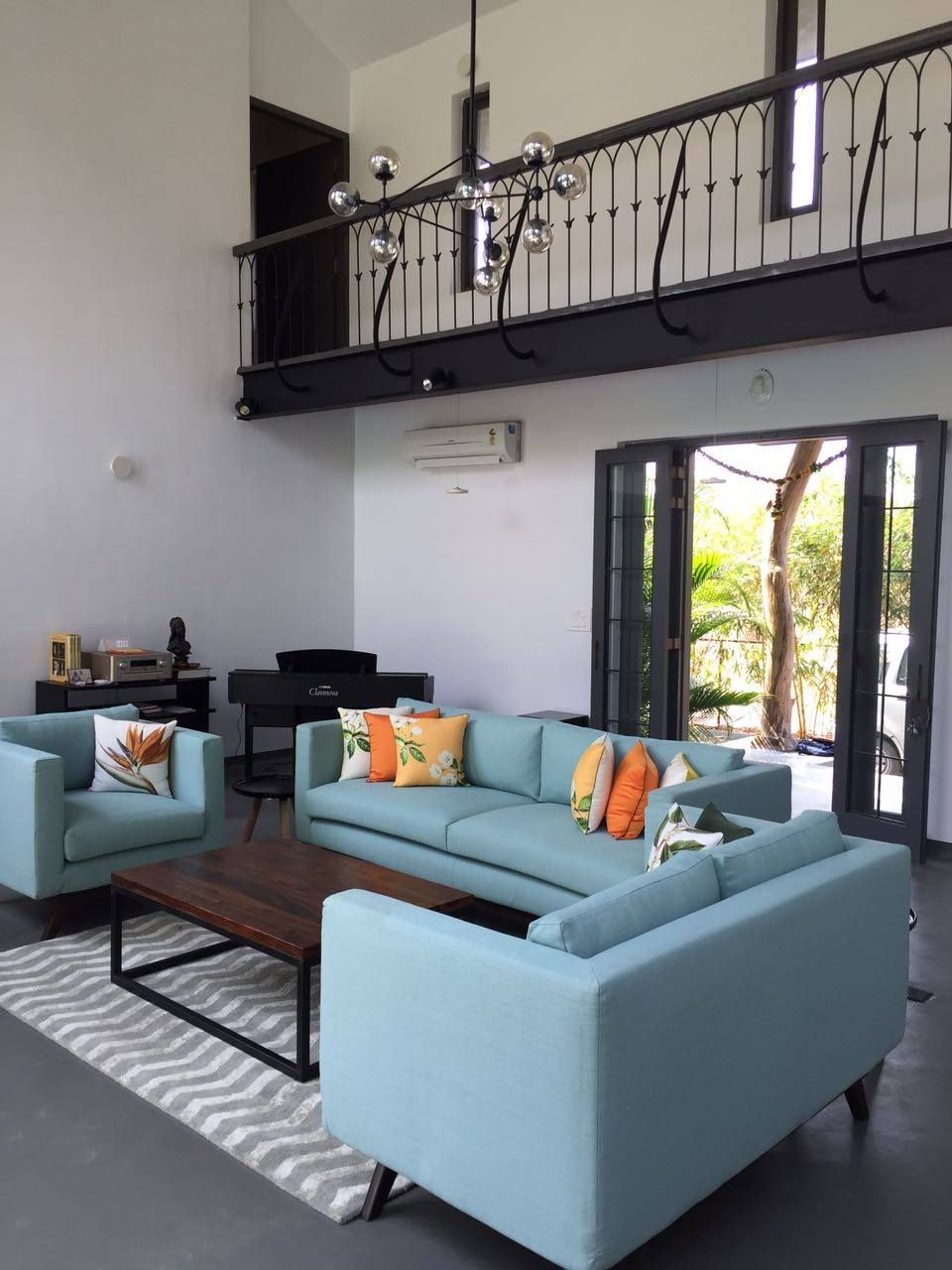 A refreshing colour scheme high ceiling and patio doors make this