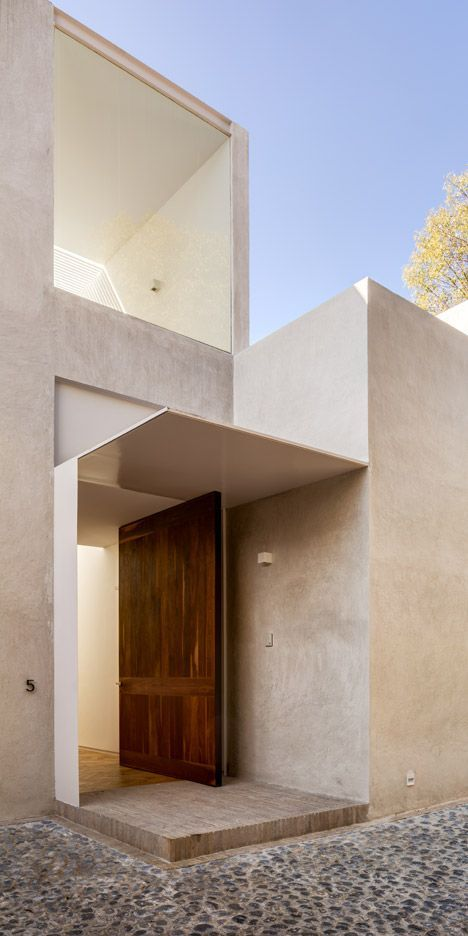 Captivating This Natural Wood Pivot Door Pops Against The Concrete Exterior Of This Modern  House In Mexico Design Ideas