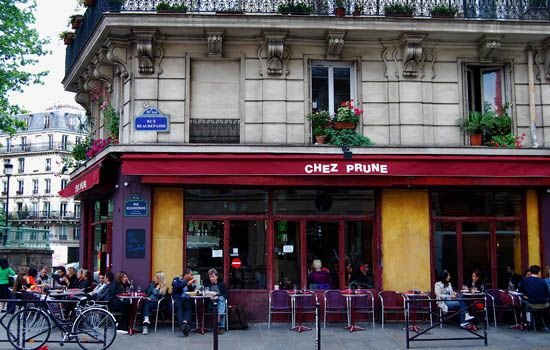 """Chez Prune, Paris, France. """"The bars, cafes, boutiques and restaurants that line the bank along the Canal Saint-Martin have transformed what was once a sleepy part of town hidden away off the Place de la République into one of the hippest parts of Paris. Chez Prune has become an institution, looking out over the canal, so arrive early if you want to grab a table outside."""" -- http://www.theguardian.com/travel/2009/apr/15/paris-pavement-cafes-bars-france"""