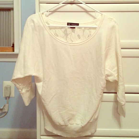 American Eagle Sweater White American Eagle Outfitters sweater with flower lace back and 3/4 length sleeves. Soft, comfortable, and goes with anything! American Eagle Outfitters Sweaters Crew & Scoop Necks