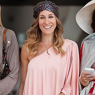 Carrie's turban from Sex and the City 2 was designed by Gold Saturn. They created the custom turban for Sarah Jessica Parker's character.     Psst: www.goldsaturn.com/