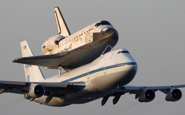 Space shuttle Discovery attached to a modified NASA 747, heading for it's final home at The Smithsonian National Air and Space Museum in Virginia.