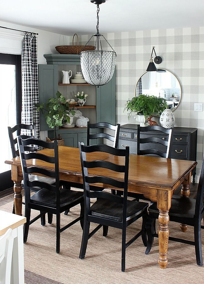 Black white and green dining room for spring.  #hymnsandverses #blackandwhite #blackwhiteandgreen #greenandblack #vintagestyle #vintagedecor #diningroom #modernfarmhouse #cornercabinet