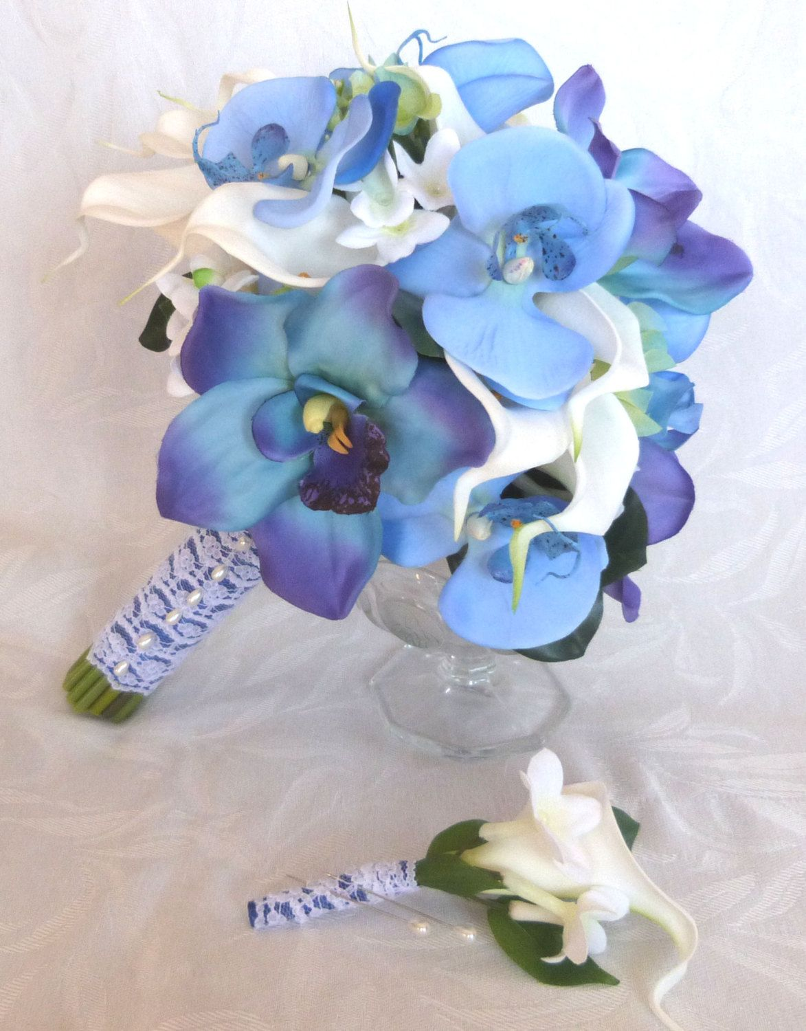 Pin by jacqueline fisher on flowers pinterest flowers awesome blue orchid white calla lily bridal bouquet and boutonniere set blue orchid bouquet izmirmasajfo