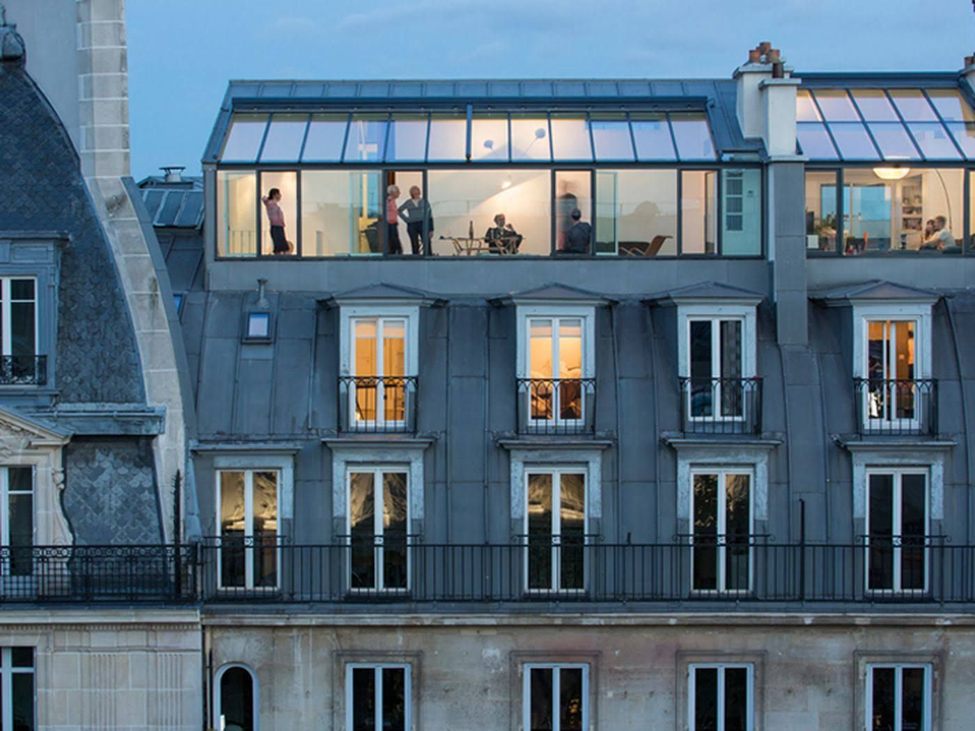 In Paris Architect Vincent Parreira Has Converted A Century Photography Studio Into Pair Of Rooftop Apartments Conceived As An Inhabited Observatory