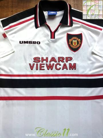 7d731bc0889 Relive Manchester United s 1997 1998 season with this original Umbro away football  shirt.