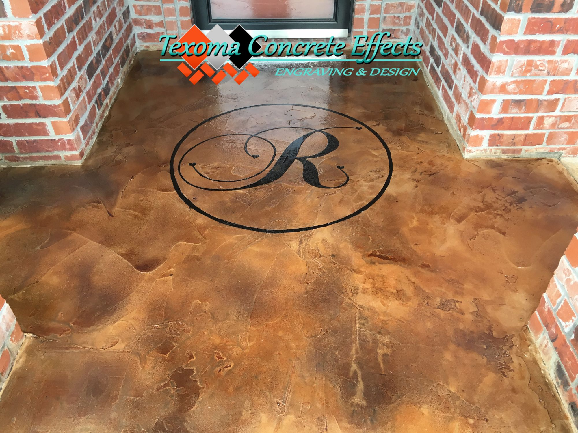 Concrete overlay with last name initial front porch by Texoma Concrete Effects, Iowa Park, TX.