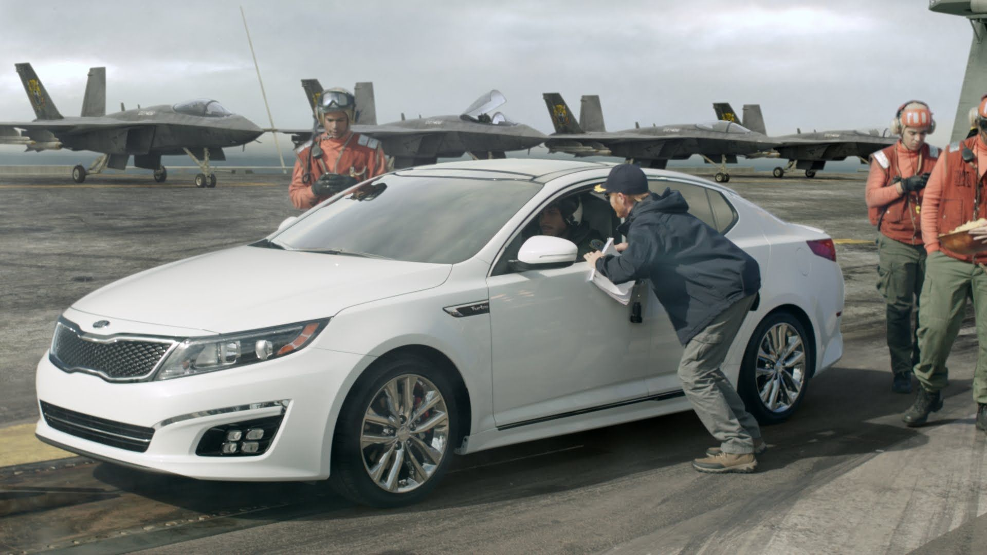 With a turbo engine, the Kia Optima flies, and fighter pilot Blake Griffin knows it. In his high-tech cockpit, it's time for Blake to destroy the enemy using the element of surprise. Over.  Prepare for take-off with the 2015 Kia Optima's power folding mirrors. It's not your average mid-size sedan.