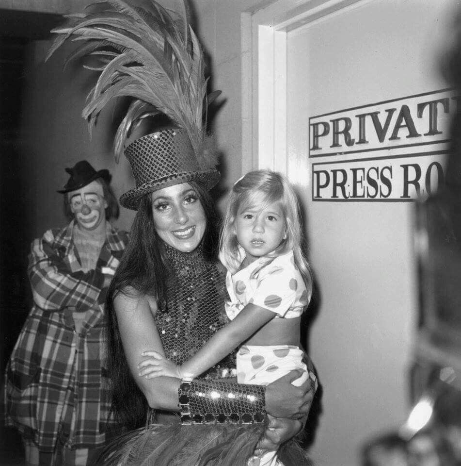 Cher & daughter Chastity backstage. 1969.  The clown doesn't look too excited!