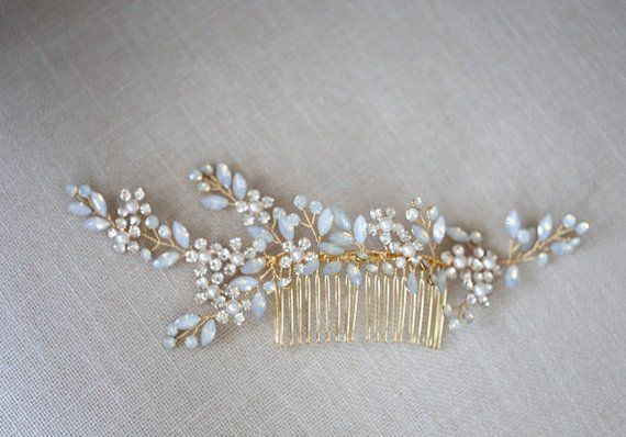 A lovely hair comb with blue rhinestone, flowers made with diamond and pearl, hand wired to a comb. Two color options, 1. Gold wire with gold comb 2. Silver wire with silver comb (back in stock Sept 7) Great for your something blue on your special day. About 15 cm wide