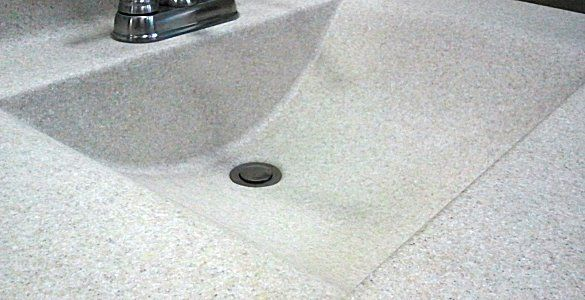 Shallow sink cast along with counter top. Solid surface and cultured ...