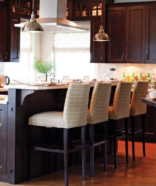 Espresso Brown Kitchen Cabinets Cream Caesar Stone Countertops Beige White Upholstered Barstools Stai Brown Kitchen Cabinets Brown Kitchens Brown Cabinets