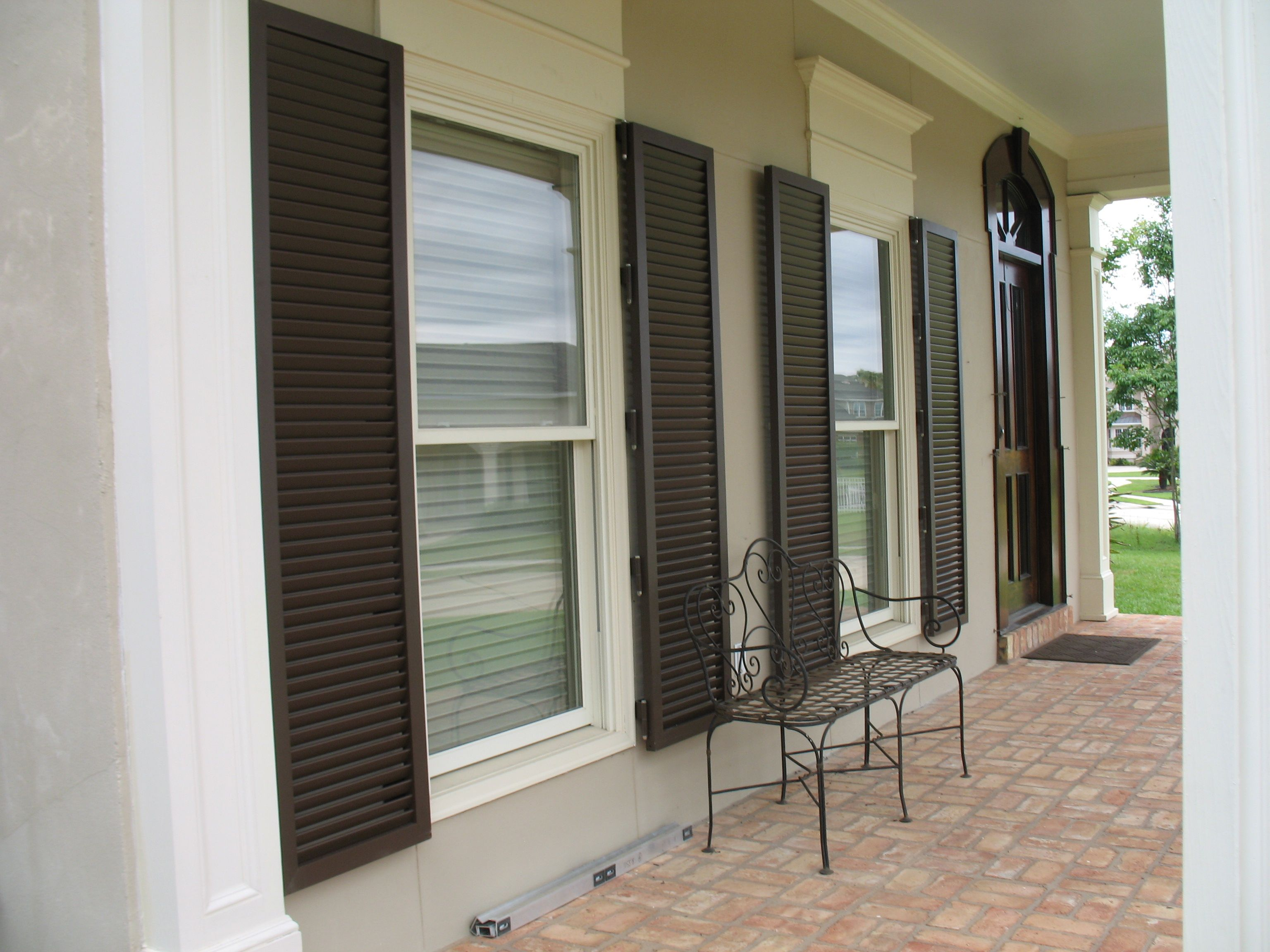 Colonial Home Without Shutters Stormsecure Impact Colonial Shutter System Exterior