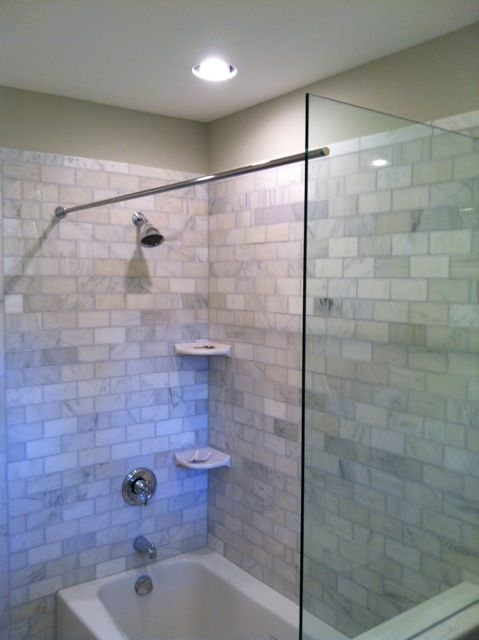 This Tub Shower Benefits From A Glass Splash Panel As Well The Rod For Curtain Frameless Seamless Enclosure In Cincinnati And