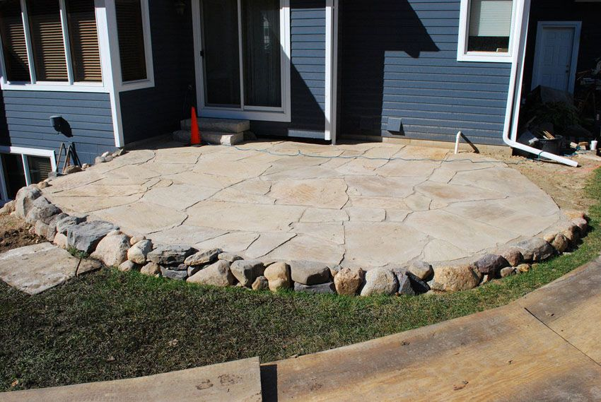 Wonderful Backyard Stone Patio With Circular Design With Small Stone Edge