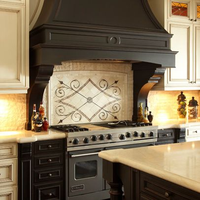 This dark wood range hood looks beautiful as a focal point in the ...