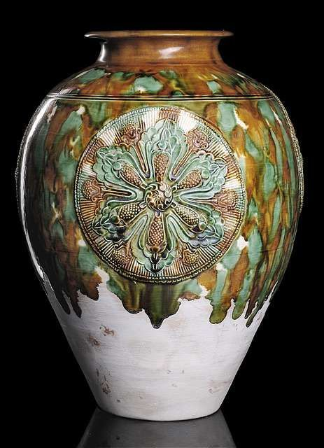 A very rare and fine ovoid jar with three moulded ...