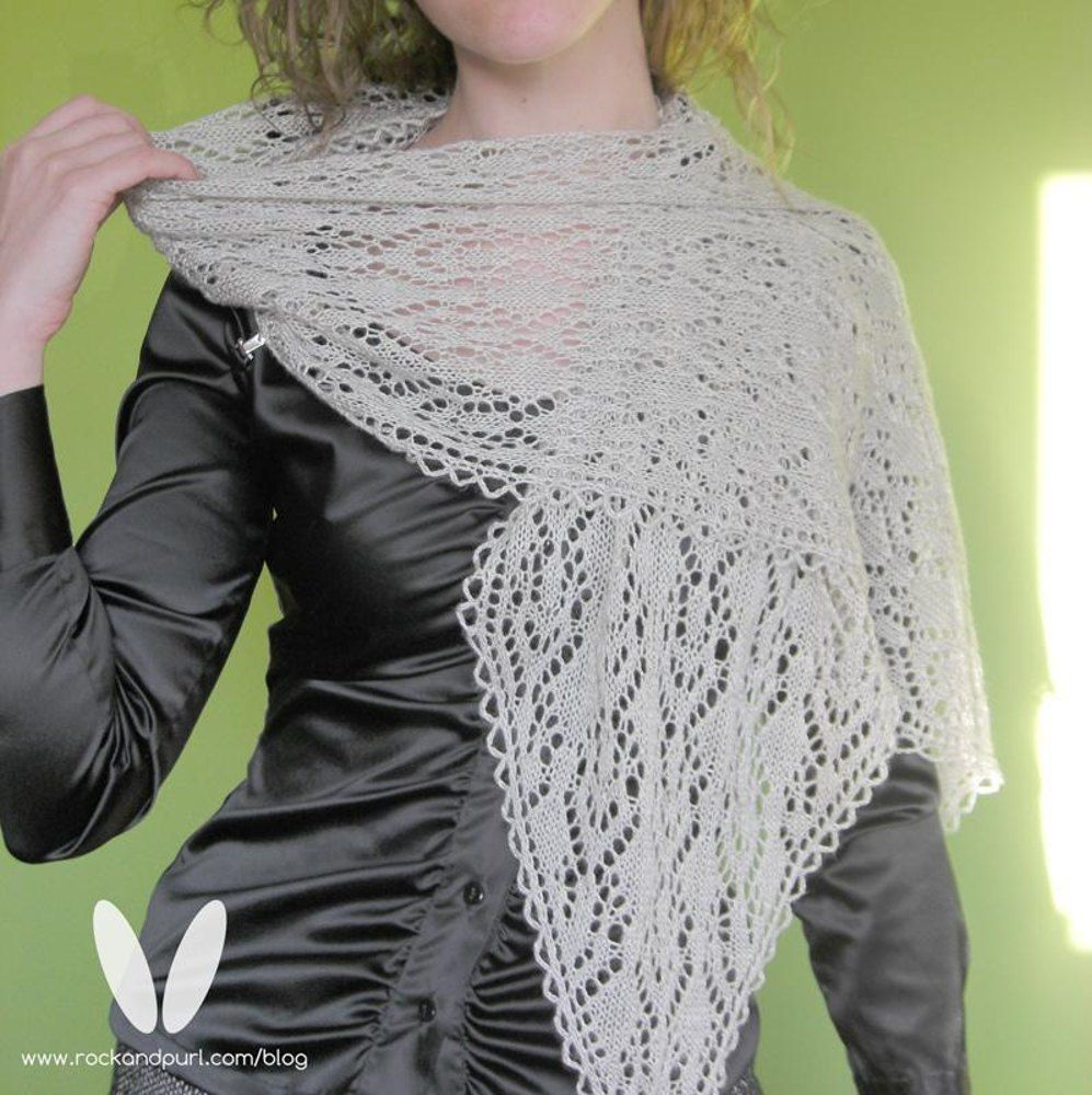 """Pronounced MY-gin WAH-ruh, this lacy pattern is reminiscing of seafoam and the sparkling views of the sea. The name means Maiden of the Sea.With arrow shaped CO and BO, this is a fast-growing pattern that features plain vanilla (purl) WS rows.Fully charted - if written instructions are desired, please let us know in the comments and we will do our best to upgrade the pattern to include them.Finished Size 68"""" (170cm) long by 13"""" (33cm) wide, blockedYarn Anzula Mermaid (60% seacell, 40% silk…"""
