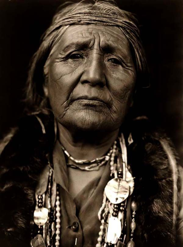 An Old Photograph Of An Native American Maiden In Traditional