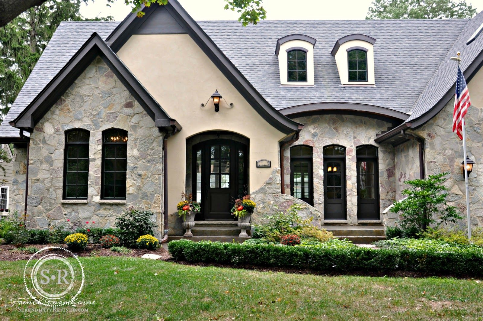 as you can see from these photos their home is a gorgeous custom stone grey stone and stucco exterior