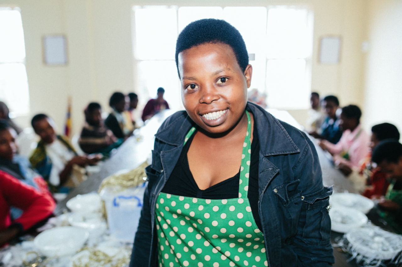 alphonsine joined ADC, the supplier for our #on_purpose label, as a friendship bracelet artisan and quickly rose through the ranks to become a team leader. now, she runs the packaging team. click to learn more.