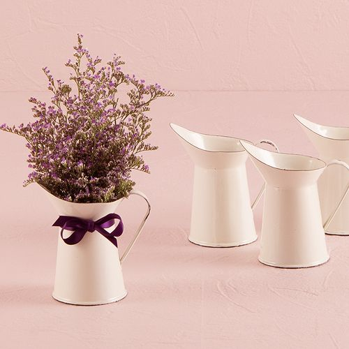 This aged miniature white enamel pitcher creates the perfect vintage vibe. Ideal for small floral arrangements or used as unique packaging for home-style treats. The result is a decoration and favor your guests can take home and enjoy. Intended for decorative use only. Available for purchase online at http://madelinesweddings.weddingstar.com/product/french-provencal-mini-decorative-pitcher